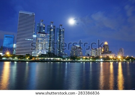 BANGKOK, THAILAND-JUNE 01 : Business area and hotel is in Bangkok city downtown at night time with reflection on wide lake in Bangkok, Thailand June 01, 2015