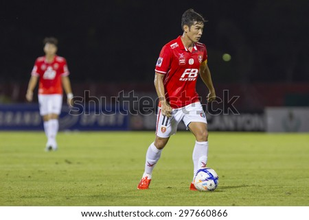 BANGKOK,THAILAND:JUNE 2015:(C)Apichet No.11of BEC-Tero;BEC-Tero Sasana(red)-SCG Muangthong United(back) at 72nd Anniversary Stadium;inThai Premier League on18July2015,Bangkok Thailand. - stock photo