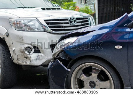 Bangkok, Thailand - June 17, 2016 : Car crash from car accident on the road in a city between saloon versus pickup wait insurance.