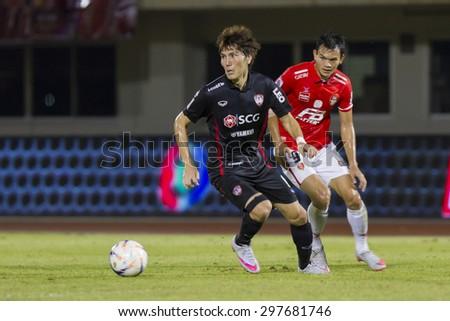 BANGKOK,THAILAND:JUNE 2015:(DF)Kim Dong Jin No.6and(FW)Adisak No.9;BEC-Tero Sasana()red-SCG Muangthong United(back)at72nd Anniversary Stadium;inThai Premier League on18July2015,Bangkok Thailand.  - stock photo