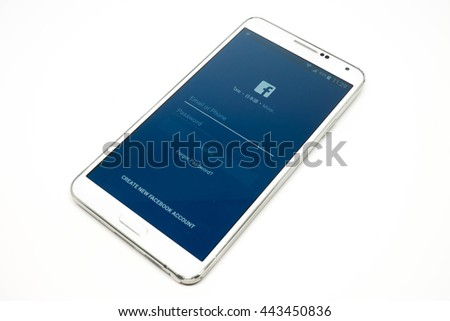 Bangkok, Thailand - June 26, 2016 : Facebook application on white mobile phone isolated, facebook is an online social networking service founded by Mark Zuckerberg. - stock photo