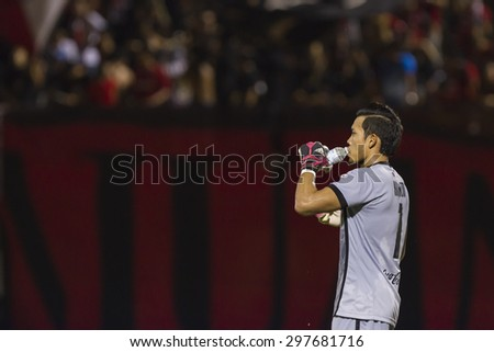 BANGKOK,THAILAND:JUNE 2015:(GK)Kawin No.1of Muangthong;BEC-Tero Sasana(red)-SCG Muangthong United(back)at72nd Anniversary Stadium;inThai Premier League on18July2015,Bangkok Thailand.  - stock photo