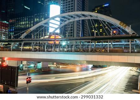 BANGKOK, THAILAND - JUNE 28, 2015: in night traffic on south sathorn road Chong Nonsi BTS skytrain Station Sathorn,Bangkok - stock photo