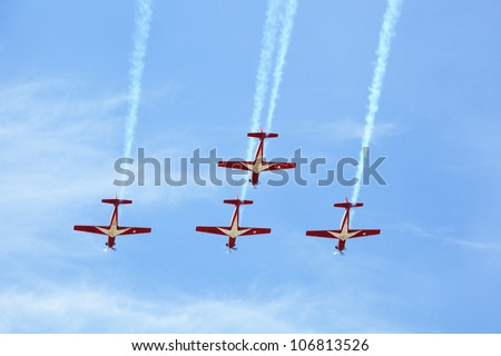 BANGKOK, THAILAND - JUNE 29: KT-1 Woong Bee from Indonesia show group flying in Cerebration of 100 year of Royal Thai air force (RTAF) at Don Muang airport on June 29,2012 in Bangkok, Thailand