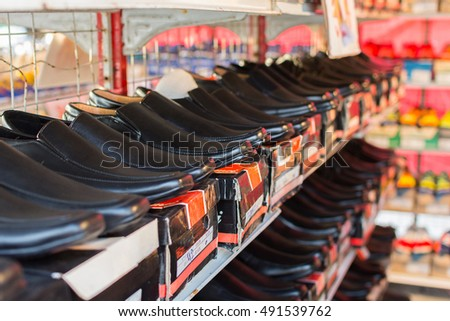 Bangkok, Thailand - June 28, 2016 : Many types of leather shoes at shoes shop.