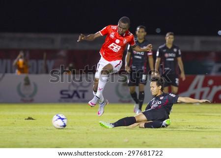 BANGKOK,THAILAND:JUNE2015:(MF)Gilbert Koomson No17and(DF)Suriya No.28;BEC-Tero Sasana(red)-SCG Muangthong United(back) at 72nd Anniversary Stadium;inThai Premier League on18July2015,Bangkok Thailand.  - stock photo