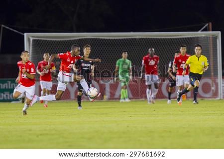 BANGKOK,THAILAND:JUNE 2015:(MF)Gilbert Koomson No.17;BEC-Tero Sasana(RED)-SCG Muangthong United(BACK)at72nd Anniversary Stadium;inThai Premier League on18July2015,Bangkok Thailand.  - stock photo