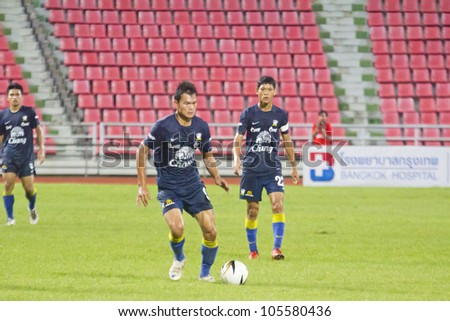 BANGKOK THAILAND - JUNE 17 : Unidentified players in Football Friendly Match 2012 (U22) between Thailand (Blue) vs Myanmar (red) on June 17,2012 at Rajamangla Stadium in Bangkok, Thailand.