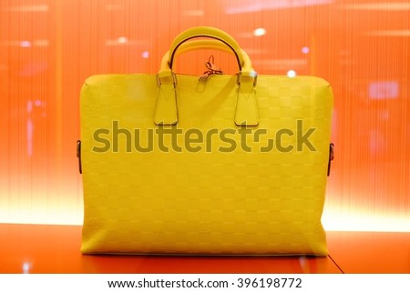 Bangkok-Thailand Mar 21 2016: Louis Vuitton (LV) shop in Siam Paragon mall with a collection of handbags that are in the showcase. - stock photo