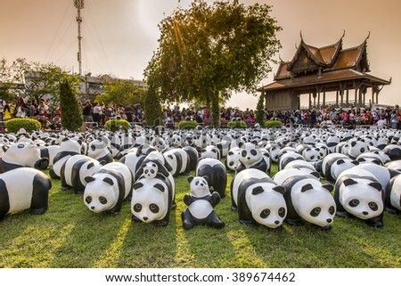 BANGKOK,THAILAND-MAR 12:1600 Pandas World Tour by WWF at Santi Chai Prakan Park on March 12, 2016. These paper marche pandas are made from recycled materials to represent 1600 pandas left in the wild. - stock photo