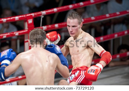 BANGKOK THAILAND- MAR 19: Unidentified players in World Thai Martial Arts Festival in Pro-Am Muaythai World Championships on MARCH 19, 2011 at MBK in Bangkok Thailand - stock photo