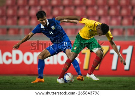 BANGKOK,THAILAND-MARCH 30:Bitolo Oyongo (yellow) of Cameroon in action during the international friendly match between Thailand and Cameroon at Rajamangala Stadium on March30 2015 in,Thailand.