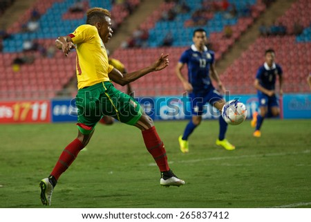 BANGKOK,THAILAND-MARCH 30:Clinton Njie  (L) of Cameroon shot the ball during the international friendly match between Thailand and Cameroon at Rajamangala Stadium on March30 2015 in,Thailand.