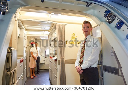 BANGKOK, THAILAND - MARCH 31, 2015: Emirates crew member meet passengers. Emirates is one of two flag carriers of the United Arab Emirates along with Etihad Airways and is based in Dubai. - stock photo