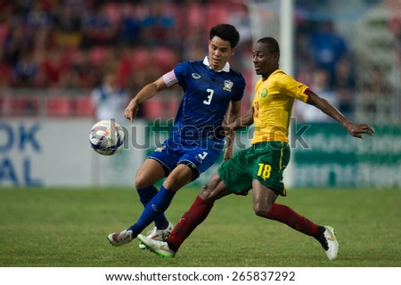 BANGKOK,THAILAND-MARCH 30:Eyong Enoh no.18(R) of Cameroon in action during the international friendly match between Thailand and Cameroon at Rajamangala Stadium on March30 2015 in,Thailand.