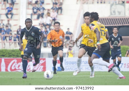 BANGKOK,THAILAND-MARCH 11 : Frang Opoku Acheampong (L) in action during Kor Royal Cupl (Charity) between Buriram UTD and Chonburi FC at National Stadium on March 11, 2012 in Bangkok, Thailand.