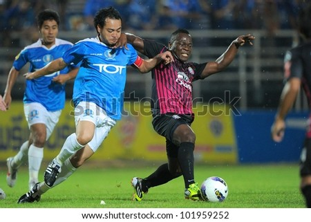 BANGKOK THAILAND-MARCH 27:Ludovick Takam (R) of Chonburion FC in action during Thai Premier League between TOT SC.(B)and Chonburion FC (R) March27,2012 in TOT Stadium Bangkok Thailand