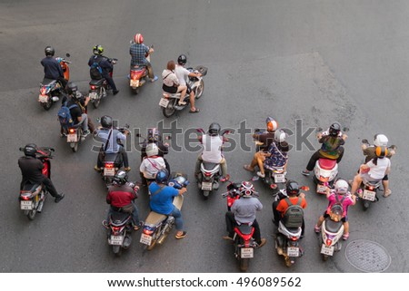 Bangkok, Thailand - March 31, 2016 : Motorcycle wait to go at intersection with traffic light on a road.