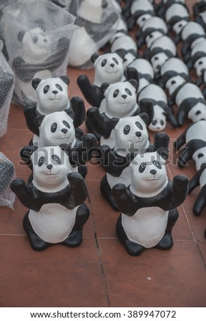 Bangkok,Thailand -March13,2016:1600 paper Mache Pandas campaign showcase in Bangkok at Giant Swing.These paper marche pandas are made from recycled materials to represent 1600 pandas left in the wild.