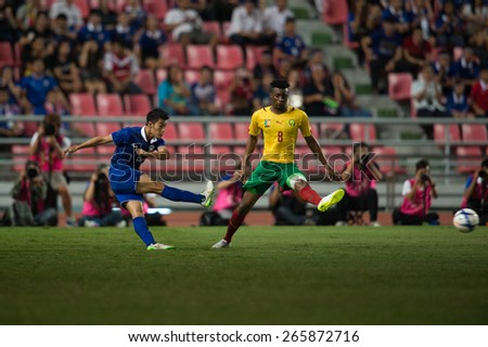 BANGKOK,THAILAND-MARCH 30:Sarach Yooyen (blue) of  Thailand and in action during the international friendly match between Thailand and Cameroon at Rajamangala Stadium on March30 2015 in,Thailand.