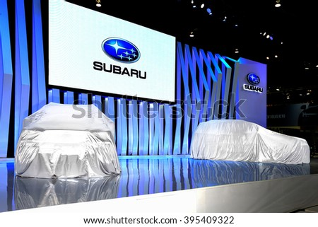 BANGKOK, THAILAND - MARCH 22 : The new model Subaru car covered by fabric wait for opening at Thailand 37th International Motorshow 2016 Arina, Muangthong Thani, on March 22, 2016. Bangkok, Thailand. - stock photo