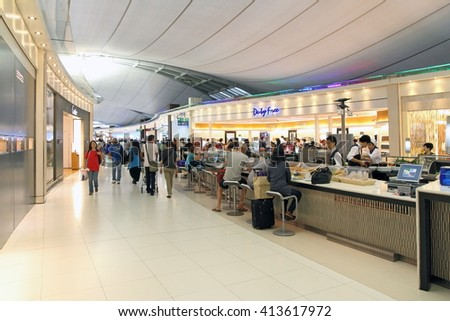 BANGKOK, THAILAND - MARCH 31, 2012: Tourists eat food in cafe of the airport - stock photo