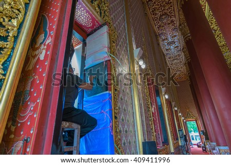 Bangkok, Thailand - March 19, 2016 : Unidentified artist drawing a striped Thai art on the temple wall at Wat Thep Sirin Thrawat Ratchaworawihan.