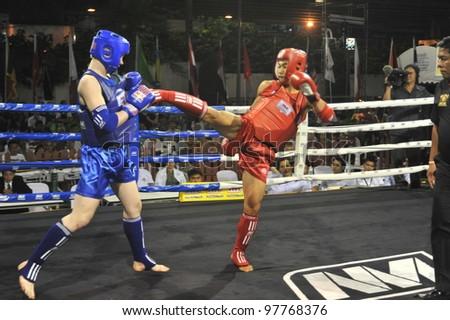 BANGKOK, THAILAND- MARCH 14 : Unidentified athletes compete in World Amateur Muaythai Champioships 2012. on March 14, 2012 at  National Stadium, Bangkok, Thailand - stock photo