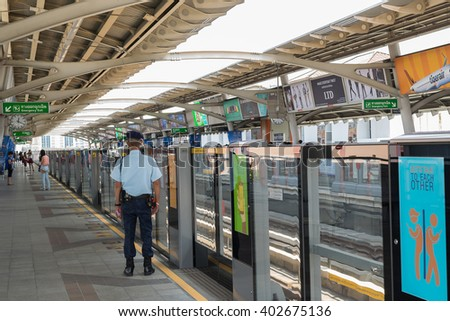 Bangkok, Thailand - March 15, 2016 : Unidentified security guard on BTS skytrain train runs in Bangkok. Many people in Bangkok used skytrain to save time.