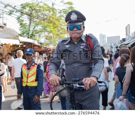 BANGKOK, THAILAND - MARCH 15 : Unidentified Thai police drives Onlywheel at Jatujak or Chatuchak Market on March 15, 2015 in Bangkok, Thailand. Jatujak Market is the largest market in Thailand. - stock photo