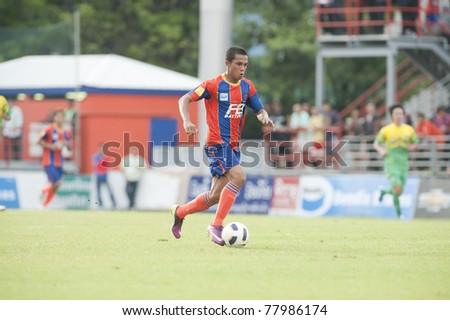 BANGKOK THAILAND- MAY 25 :A.Sumre (red) in action during Thai Premier League (TPL) between thai port fc (Orange) vs TTM Pijit (yellow)   on Msy 25, 2011 at PAT Stadium in Bangkok Thailand