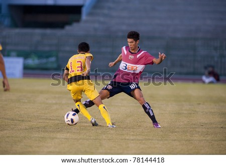 BANGKOK, THAILAND- MAY 28: C.Tatong (R) in action during Thai Premier League (TPL) Divition 1 between BB-CU Fc (P) vs Cat Today Janburi (Y) on May 28, 2011 at Army Stadium in Bangkok, Thailand