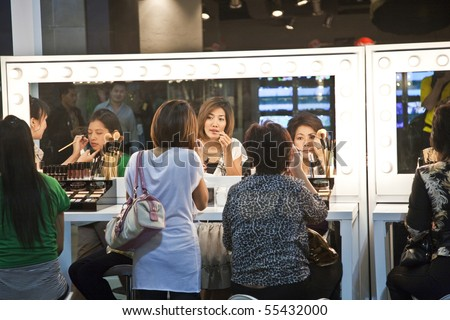 BANGKOK, THAILAND - MAY 11: cosmetic company AMWAY sponsors a makeup course with its products in the central world center and assists woman in using products, May 11, 2009 in Bangkok, Thailand