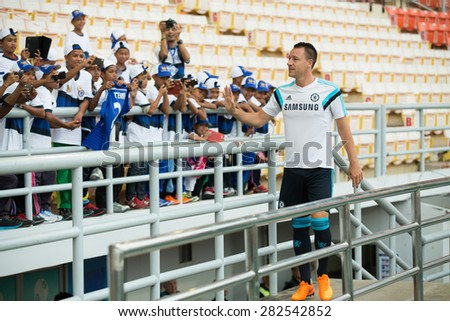 BANGKOK THAILAND MAY 29,John Terry of Chelsea FC  in action to fans during a Chelsea FC training session at  Rajamangala Stadium on May 29,2015 in Bangkok Thailand  - stock photo