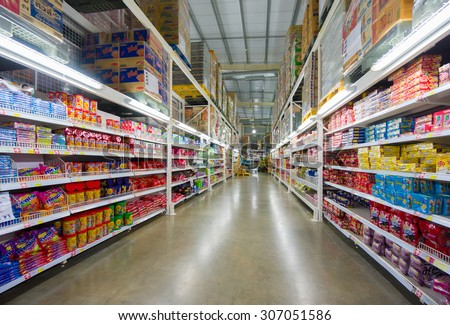 Bangkok, Thailand - 22 May 2015: Rows of shelves with products boxes in Makro warehouse, Bangkok, Thailand. - stock photo