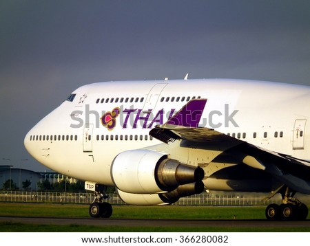 Bangkok Thailand  MAY 20 2014:Thai Airways Boeing 747-400 while taxi in the evening at Suvanabhumi Airport. - stock photo