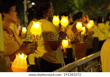 Bangkok, THAILAND - May 5: Thai people ceremony for Candles Loyal for the H.M.K. Bhumibol Adulyadej Birthday on May 5, 2014 at Sanamluang,Bangkok,Thailand - stock photo