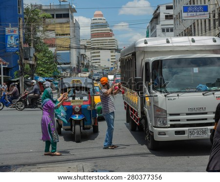 "BANGKOK THAILAND-MAY 22: Thai Sikhs distributed free beverages to the general public commuters passing The day commemorate the ""conscripted escort justified"" On May 22,2015 at phahurat road Thailand"