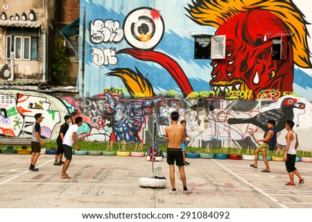 BANGKOK, THAILAND - MAY 6 : Unidentified men play Sepaktakraw (Rattan Ball) with street art wall background on MAY 6, 2015 in Bangkok, Thailand - stock photo