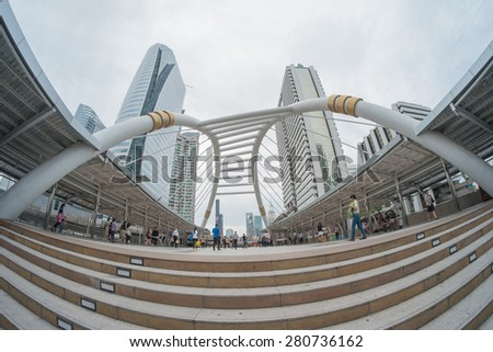 Bangkok,Thailand -  May 13,2015 : Unidentified people walk on skywalk in Sathorn district,Bangkok,Thaland.