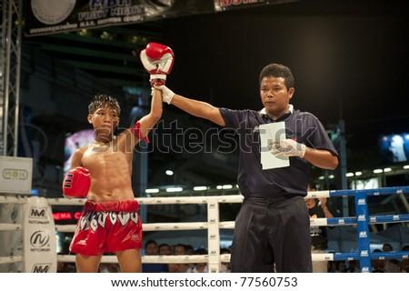 "BANGKOK THAILAND- MAY 18: Unidentified player in Muaythai "" MBK Fight Night"" on May18, 2011 at MBK Shopping Center in Bangkok Thailand - stock photo"