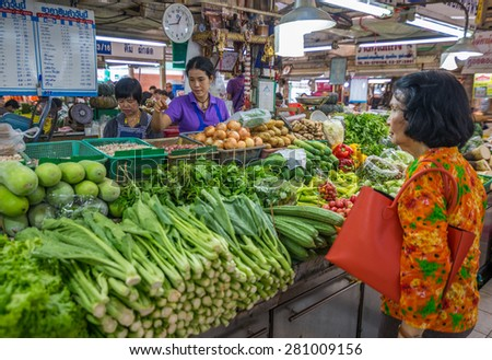 Bangkok, Thailand - May 23, 2015 Unidentified woman is selling fresh vegetable at Or Tor Kor markrt, a well known place for fresh food, fruits and foods. Located next to Jatujak market.