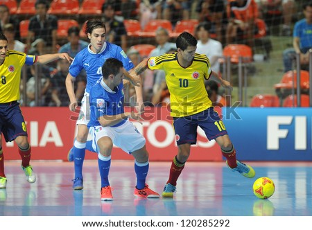 BANGKOK, THAILAND-NOV 18: Angellote Caro of Colombia (y) in actionl during the FIFA Futsal World Cup between Italy and Colombia at Indoor Stadium Huamark on Nov18,2012 in Bangkok,Thailand. - stock photo