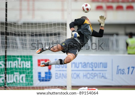 BANGKOK THAILAND - NOV 15:Australian goal keeper Adem Faderic in action during The FIFA WORLD CUP 2014 between Thailand(B) and Australia (Y) at Supachalasai Stadium on Nov 15, 2011 Bangkok, Thailand. - stock photo