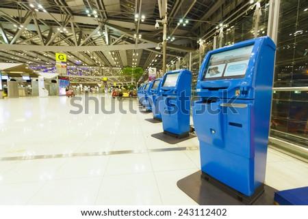 BANGKOK, THAILAND - NOV 07: check-in self service terminals on November 07, 2014. Suvarnabhumi Airport is one of two international airports serving Bangkok. - stock photo