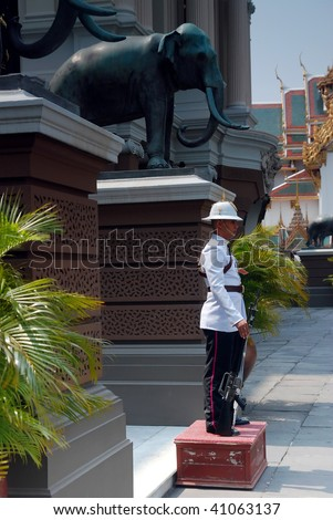 BANGKOK, THAILAND - Nov 2: Guard stands still in front of The Grand Palace November 2, 2009 in Bangkok, Thailand