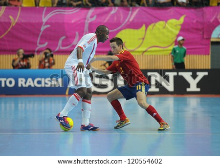BANGKOK, THAILAND - NOV 14:Lin of Spain (r) in action during the FIFA Futsal World Cup Quarterfinal Round between Spain and Russia at Nimibutr Stadium on Nov14,2012 in Bangkok, Thailand.