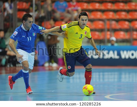 BANGKOK, THAILAND-NOV 18: Luis Berrenche of Colombia (y) in action during the FIFA Futsal World Cup between Italy and Colombia at Indoor Stadium Huamark on Nov18,2012 in Bangkok,Thailand. - stock photo