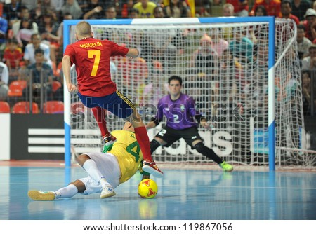 BANGKOK, THAILAND - NOV 18 :Miguelin (7) of Spain during action in FIFA Futsal World Cup Thailand 2012 Between Spain VS Brazil on November 18, 2012 at Indoor Stadium Huamark in Bangkok Thailand. - stock photo