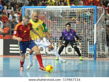 BANGKOK, THAILAND - NOV 18 : Miguelin of Spain during action in FIFA Futsal World Cup thailand 2012 Between Spain (R) VS Brazil (Y) on November 18, 2012 at Indoor Stadium Huamark in Bangkok Thailand. - stock photo